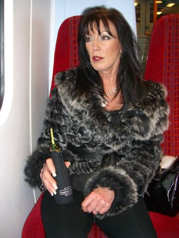 Claire on Train Drinking Champagne